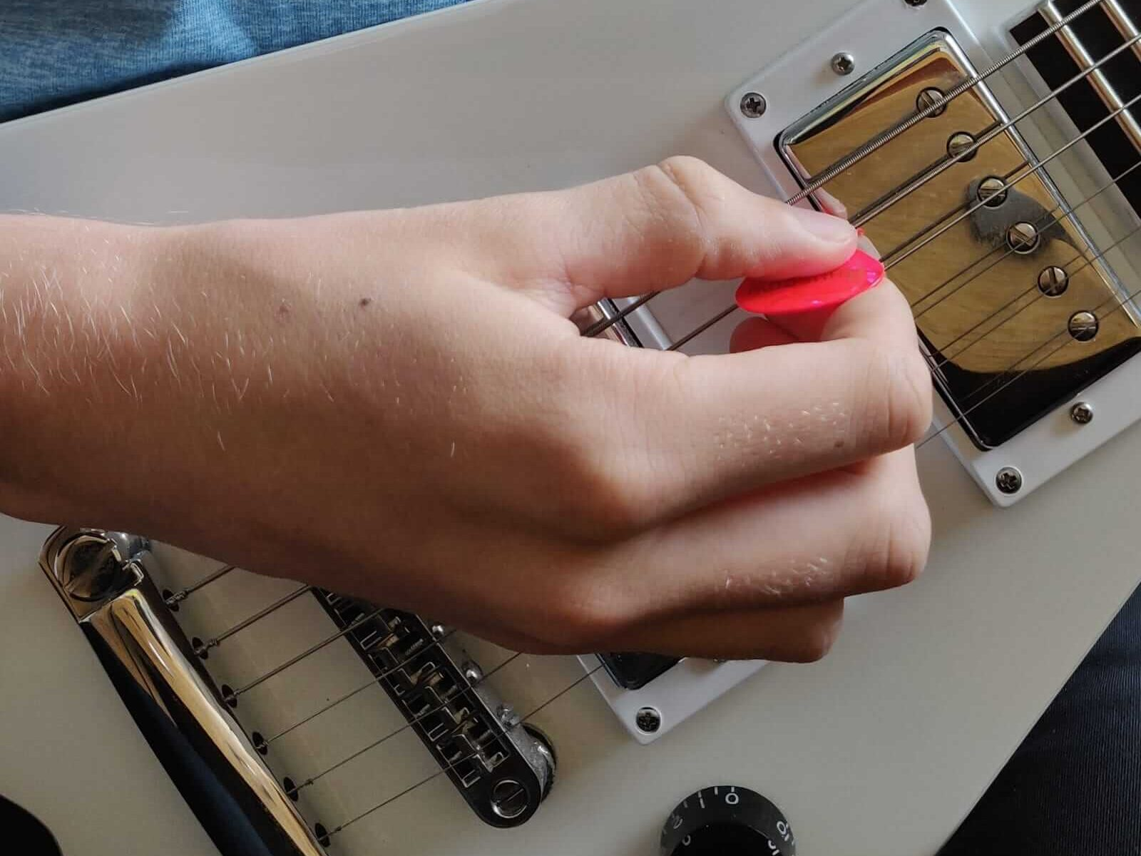 How to rest your picking hand in a way that lets you play fast without tension.
