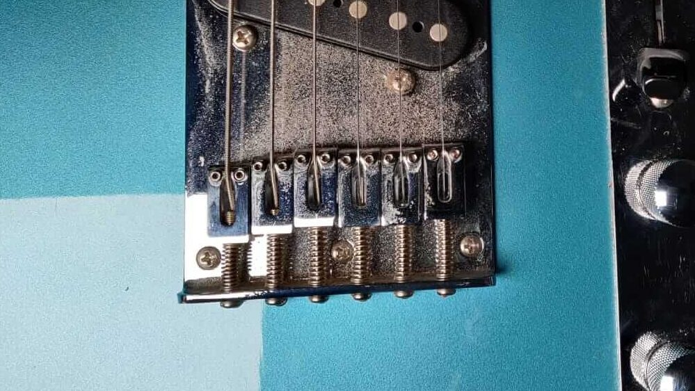 Guitar action screws on a Squier
